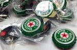 65 total in this Heineken Beer bottle cap mem...