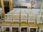 Lot of 30 matching solid wood dining chairs. ...