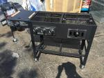 New barbecue grill on casters left side is ga...